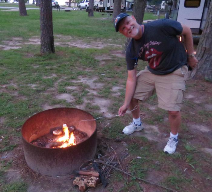 Grilling Marshmallows for S'mores - YUM!