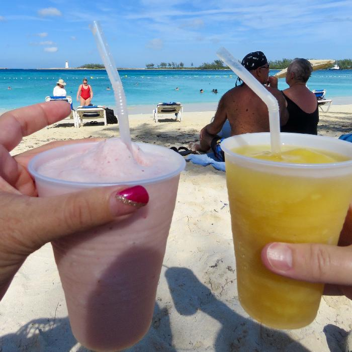 Enjoying a Smoothie from Crabs n' Things at Junkanoo Beach in Nassau, Bahamas