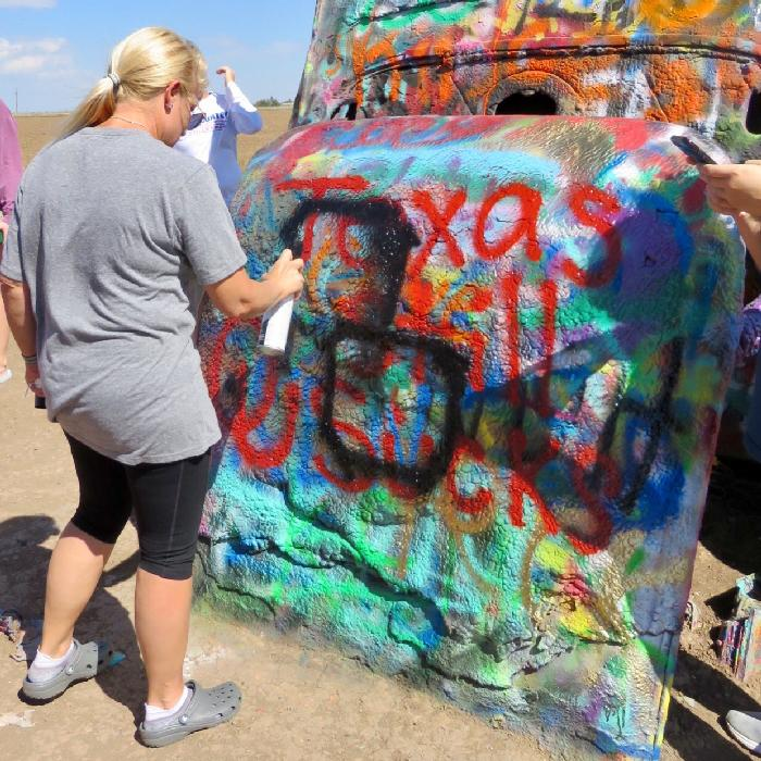 Spraying Support of the Texas Longhorns at Cadillac Ranch