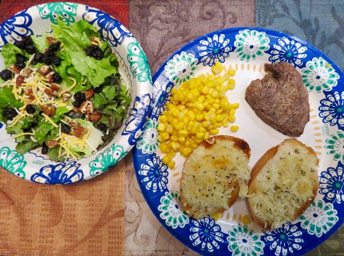 Steak with Corn, Garlic Bread and Dinner Salad